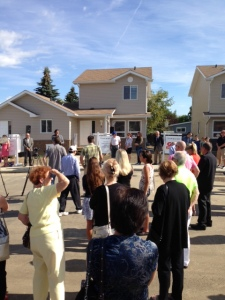 MLA Stephen Khan congratulates the last ten families on receiving their Habitat homes.